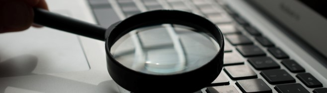 cropped-magnifying-glass-qualify
